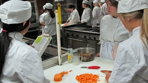 Thunder Bay high school students take part in a summertime dual-credit program at Confederation College. Pictured here are students learning to make a healthy meal in a cooking course.