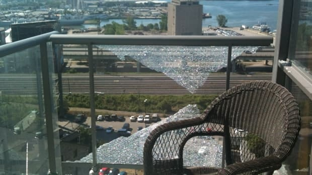 The glass shattered on Ken McNeilly's 15th floor balcony.
