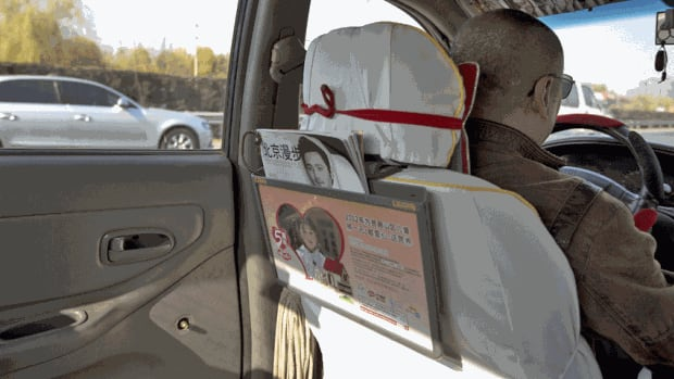A photo from the back seat of a Beijing taxi shows where a window handle on the door has been removed, as part of a series of bizarre security measures ahead of Beijing's Communist Party congress.
