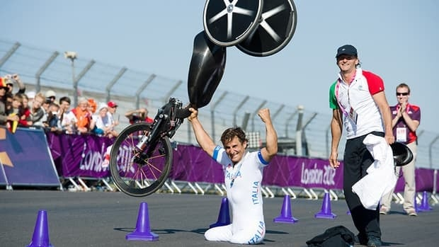 Former race car driver Alex Zanardi of Italy celebrates after winning the gold medal in the men's individual H4 time trial cycling final during the London 2012 Paralympic Games at Brands Hatch circuit, in Kent, southern England on September 5, 2012.