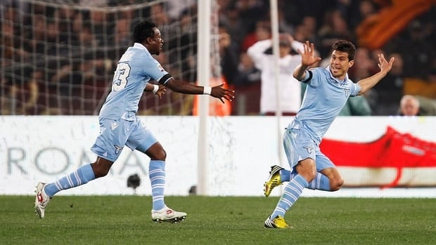 Lazio's Hernanes, right, celebrates after scoring against Roma on Monday.