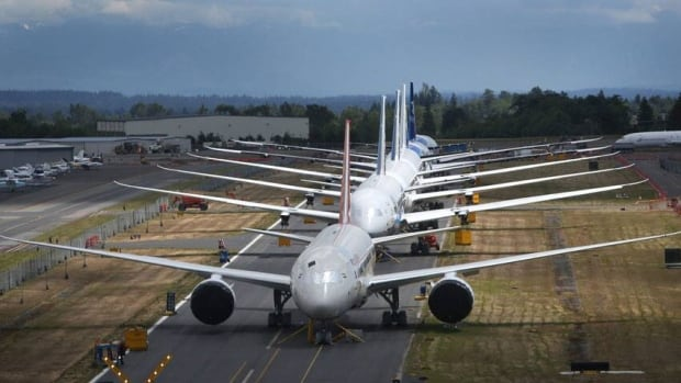 A line of Boeing 787 Dreamliners waiting to be delivered are shown on a closed runway on June 18. Transport Canada has ordered inspections of Boeing, Airbus and other airplane beacons after a fire on a plane in London.