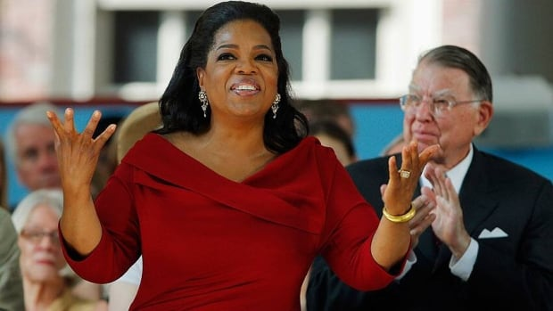 Media mogul Oprah Winfrey, seen delivering the 2013 Harvard University commencement address in May, regained the top spot on the Forbes list of the world's most powerful celebrities.