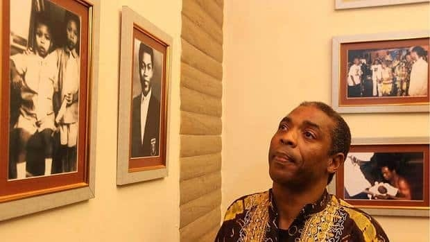 Musician Femi Kuti, the son of late Afrobeat pioneer Fela Kuti, looks at portraits of his father at the opening of the Kalakuta Museum in Lagos on Monday, which marked what would have been his 74th birthday.