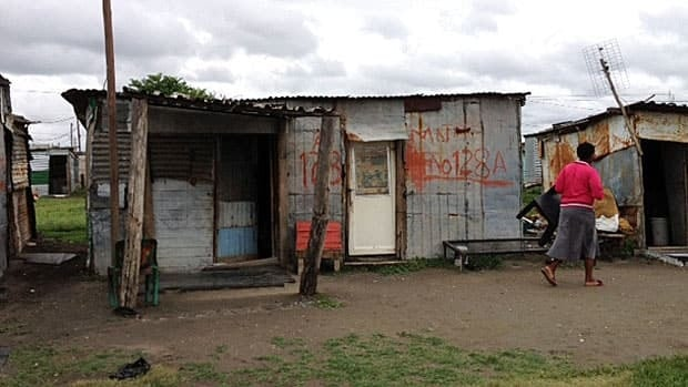 There are paved roads and electricity in the mine itself, but not in the shacks, like these, where most of the Lonmin miners live.