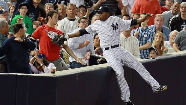 Dewayne Wise of the New York Yankees falls into the stands after trying to make a catch against the Cleveland Indians on Tuesday night.