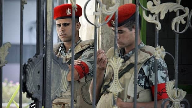 Egyptian soldiers stand guard Wednesday outside Cairo's Maadi military hospital where former president Hosni Mubarak was transferred from a prison hospital.