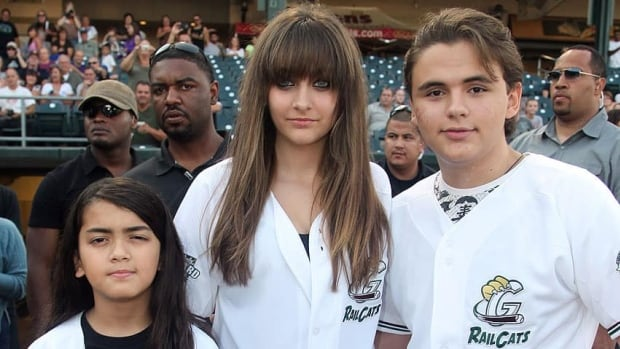 Prince Jackson, right, is seen with his siblings Blanket, left, and Paris in Gary, Ind., last August. He was the first Jackson to testify in his family's lawsuit claiming concert promoter AEG negligently hired Conrad Murray, who was convicted in his father's death.