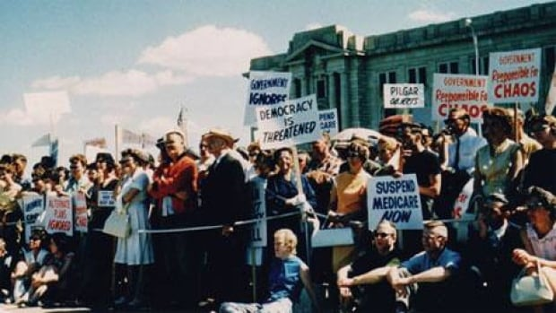People supporting doctors in the medicare crisis rallied at the legislature on July 11, 1962.