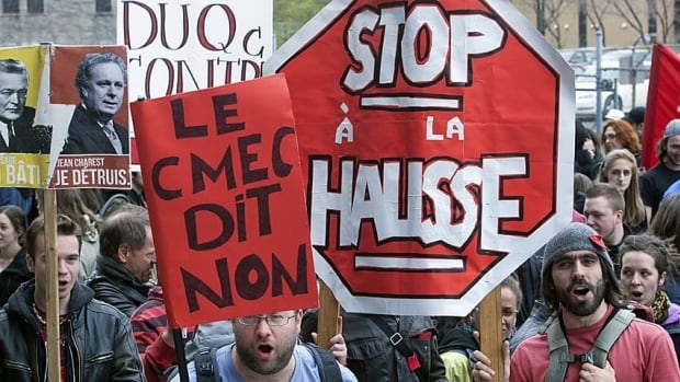 Students protest against tuition fee hikes in front of the Education Ministry office on April 26 in Montreal.