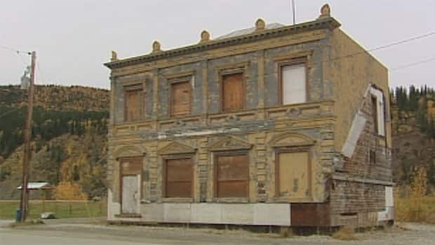 Renovations to Dawson City's historic CIBC bank are on hold due to the discovery of lead paint and asbestos.