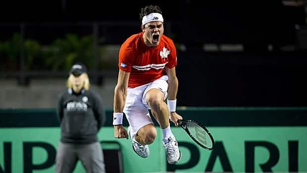 Milos Raonic celebrates during Canada's Davis Cup win over Italy.