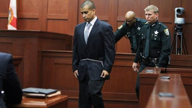 George Zimmerman walks back to his seat after taking the stand during his bail hearing Friday in Sanford, Fla. A judge said he can be released on a $150,000 US bond as he awaits trial for the shooting death of Trayvon Martin.