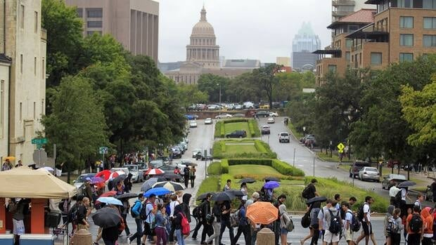 University of Texas students evacuate the campus in Austin, Texas, after the school received a bomb threat Friday.