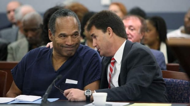 Disgraced former football great O.J. Simpson, left, with his attorney ...