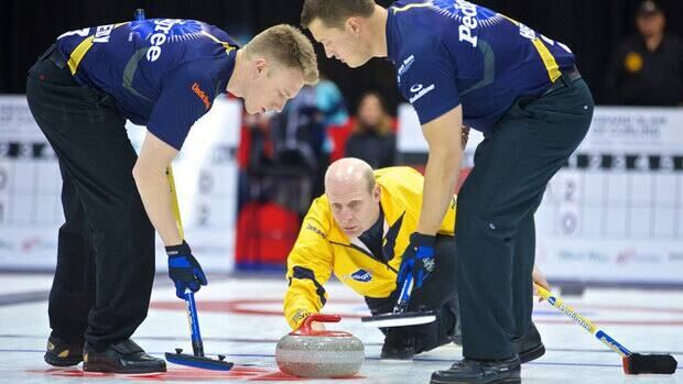 Kevin Martin delivers a stone during his opening game at the Rogers Masters of Curling.
