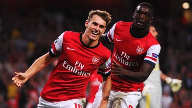 Aaron Ramsey of Arsenal, left, celebrates with teammate Yaya Sanogo after scoring against Fenerbahce at Emirates Stadium on August 27, 2013 in London, England.