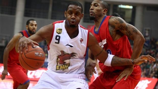 In this Nov. 2012, Tracy McGrady, left, is seen competing with the Qingdao DoubleStar Eagles.