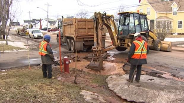 Charlottetown city crews dig to repair a water main break.
