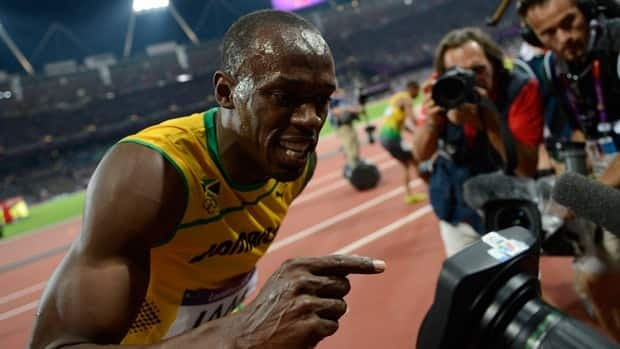 Jamaica's Usain Bolt celebrates after Jamaica won the men's 4X100 relay at the London 2012 Olympic Games on August 11, 2012.