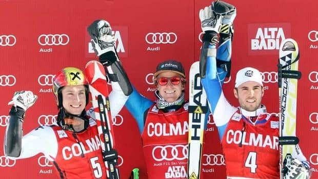 Ted Ligety, centre, celebrates on the podium with second place finisher Marcel Hirscher, left, and third place finisher Thomas Fanara, in Alta Badia, Italy on Sunday.