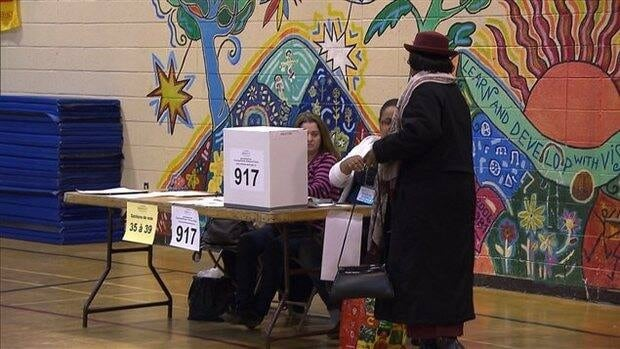 A resident of Rivière-des-Prairies votes for a new councillor Sunday morning.