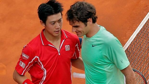 Kei Nishikori from Japan, left, hugs Roger Federer from Switzerland after his latest big victory in Madrid on Thursday.
