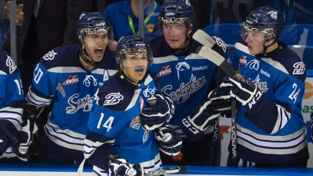 Saskatoon Blades forwards Josh Nicholls, left, Michael Ferland, back centre, and Collin Valcourt congratulate teammate Matej Stransky (14) on his goal against the Halifax Mooseheads during the first period in Saskatoon, Sask. on Sunday.