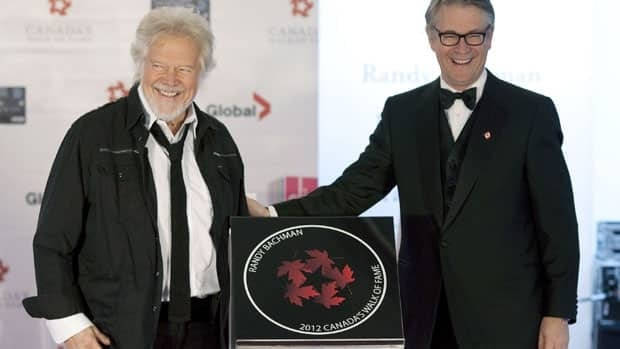 Musician Randy Bachman (left) stands with Bruce Rothney, Chairman of Canada's Walk of Fame as the guitar great is inducted into Canada's Walk of Fame in Toronto.
