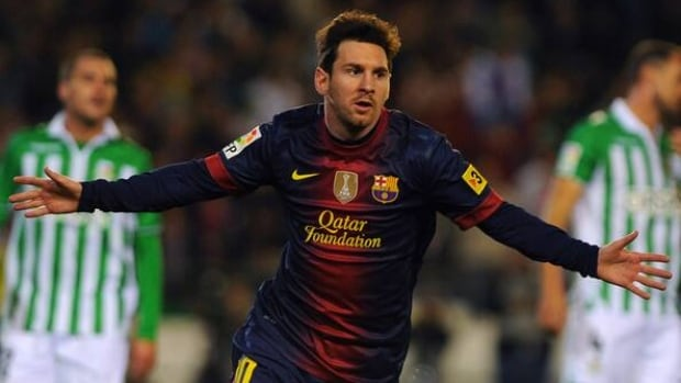Barcelona's Lionel Messi celebrates after scoring against Real Betis on December 9, 2012 at the Benito Villamarin stadium in Sevilla.