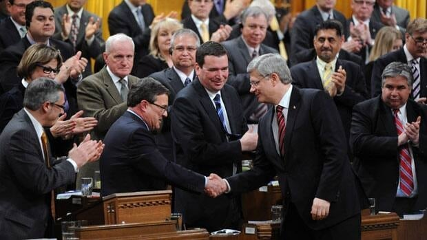 Minister of Finance Jim Flaherty shakes hands with Prime Minister Stephen Harper after delivering the Budget in the House of Commons on Parliament Hill in Ottawa on Thursday, March 29, 2012.