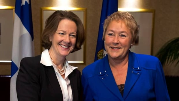 Alberta Premier Alison Redford, left, and Quebec Premier Pauline Marois met during the premiers meeting in Halifax last November. Both won provincial elections in 2012, bringing the number of female premiers to a record-breaking five.
