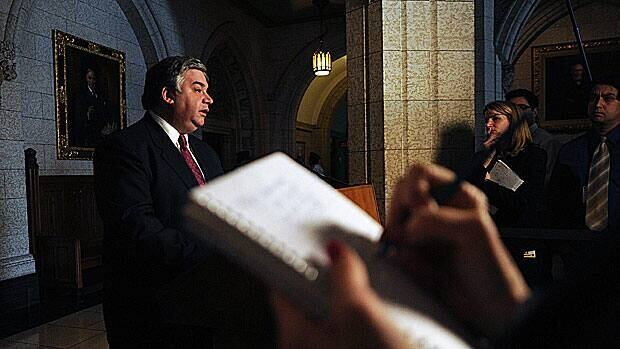 Government House leader Peter Van Loan speaks to reporters in the foyer of the House of Commons as MPs returned to Ottawa after a six-week break.