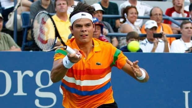 Milos Raonic returns a shot to James Blake in the third round at the U.S. Open on Saturday in New York.