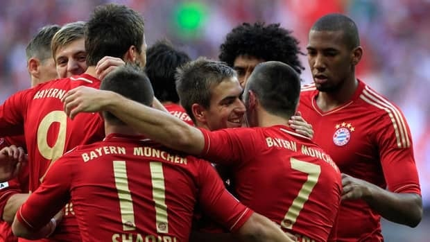 Bayern Munich's Franck Ribery is embraced by teammates after scoring during their match against Hoffenheim in Munich on Saturday.