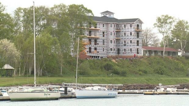 The River House Inn, which looks over the Montague River, is expected to open in August.