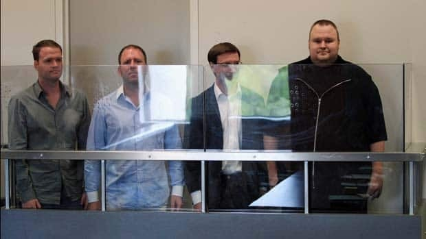 Megaupload.com employees Bram van der Kolk, also known as Bramos, left, Finn Batato, second from left, Mathias Ortmann and founder, former CEO and current chief innovation officer of Megaupload.com Kim Dotcom (also known as Kim Schmitz and Kim Tim Jim Vestor), right, appear in North Shore District Court in Auckland, New Zealand. Greg Bowker/New Zealand Herald/Associated Press