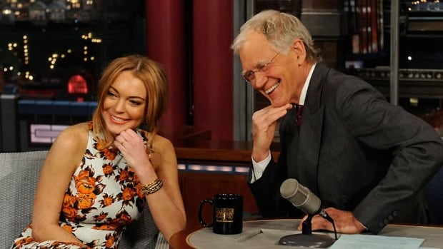 Actress Lindsay Lohan poses with Late Show host David Letterman on Tuesday.