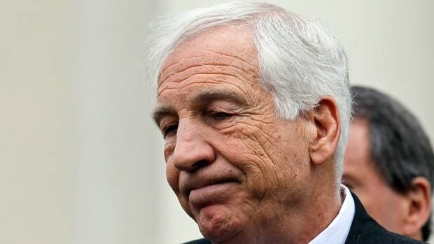 Jerry Sandusky, a former Penn State assistant football coach charged with sexually abusing boys, pauses while speaking to the media at the Centre County Courthouse after a bail conditions hearing.