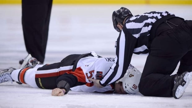 Ottawa's Dave Dziurzynski lies on the ice following his fight with Toronto's Frazer McLaren on Wednesday night.