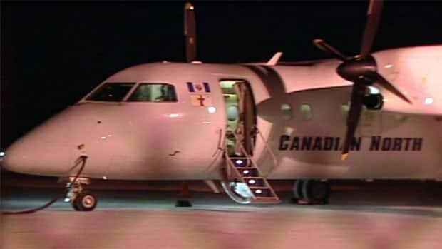 A Canadian North Dash 8 aircraft, like this one seen in Yellowknife, was broken into in Pond Inlet, Nunavut, Wednesday night. The airline says it will no longer leave its planes overnight in the community until airport security improves.