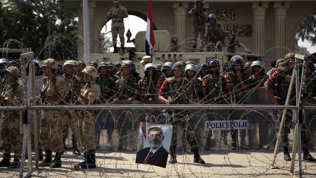 Egyptian soldiers stand guard in Cairo, July 5, two days after the head of the armed forces promised early presidential elections. When a military topples a democratically elected government, a hasty return to democracy is a rare event