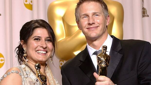 Saving Face filmmakers Sharmeen Obaid-Chinoy, left, and Daniel Junge pose with their awards for best documentary short during the Academy Awards on Sunday.