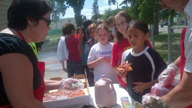 Youngsters enjoy healthy snacks at Pleasant Hill Park as part of a summer program, in its 25th year, by the Saskatoon & District Labour Council.