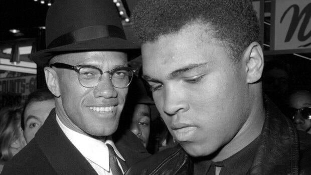 Malcolm X, left, is shown March 1, 1964 with heavyweight boxing champion Muhammad Ali. Historian Manning Marable's Malcolm X biography has won the Pulitzer Prize.