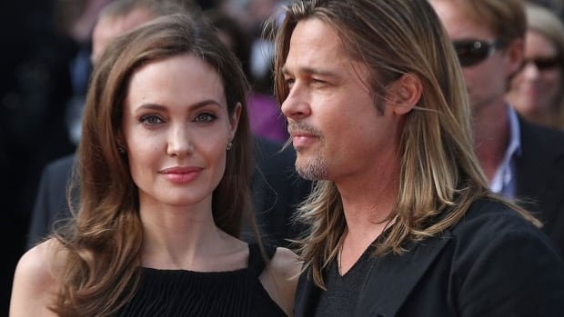 Angelina Jolie, seen with partner Brad Pitt in London in June, tops the 2013 Forbes list of Hollywood's highest-paid actresses.