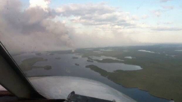 A forest fire continues to burn out of control Monday near Ilford and War Lake First Nation.