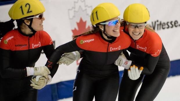 Canadians Caroline Truchon, left, Marianne St-Gelais, centre, and Jessica Gregg celebrate after their win in the women's 500-metre final A in Montreal on Sunday.