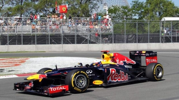 Red Bull driver Sebastian Vettel drives through the famous hairpin on the Circuit Gilles Villeneuve at Montreal on Saturday. He has the pole for Sunday's race.