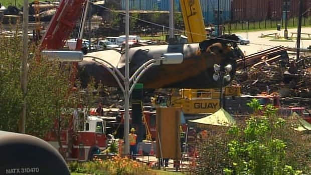 Work resumed Sunday morning after specialized equipment was delivered to Lac-Mégantic from Montreal.
